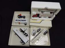 Group of 4 Die-Cast Semi Trucks Featuring Roadway,