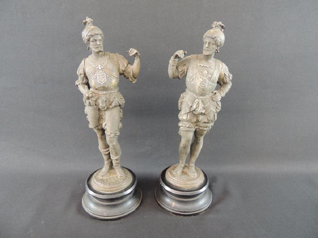 Group of 2 Statues of Men with Helmets