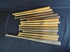 Group of 14 Miniature Louisville Slugger Bats