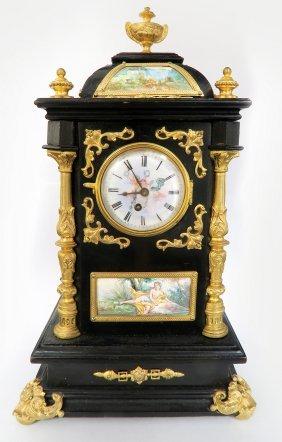 AUSTRIAN BRONZE-GILT, ENAMEL AND WOOD TABLE CLOCK CABIN