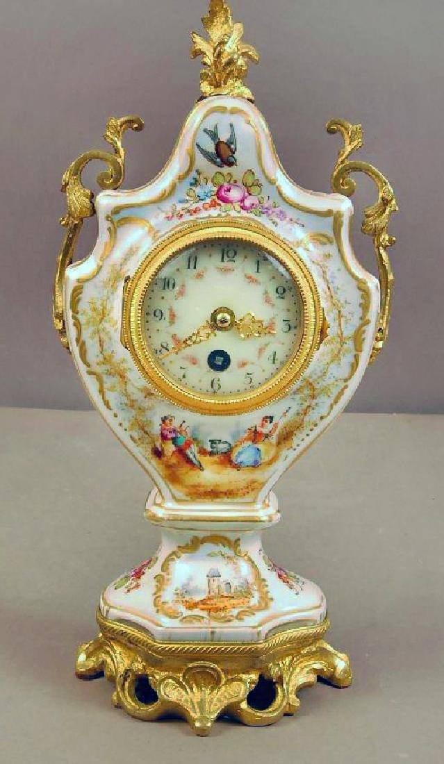 French Louis XV Serves Dore Bronze & Porcelain Clock
