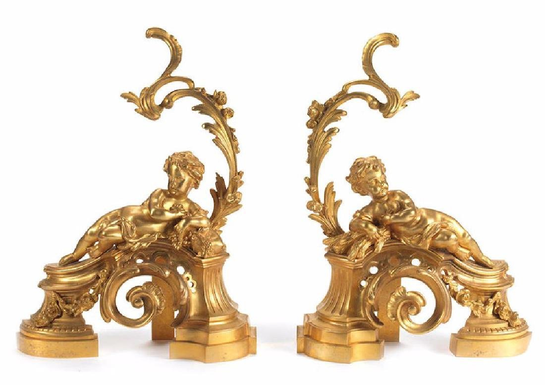 A PAIR OF FRENCH GILT BRONZE FIGURAL CHENETS