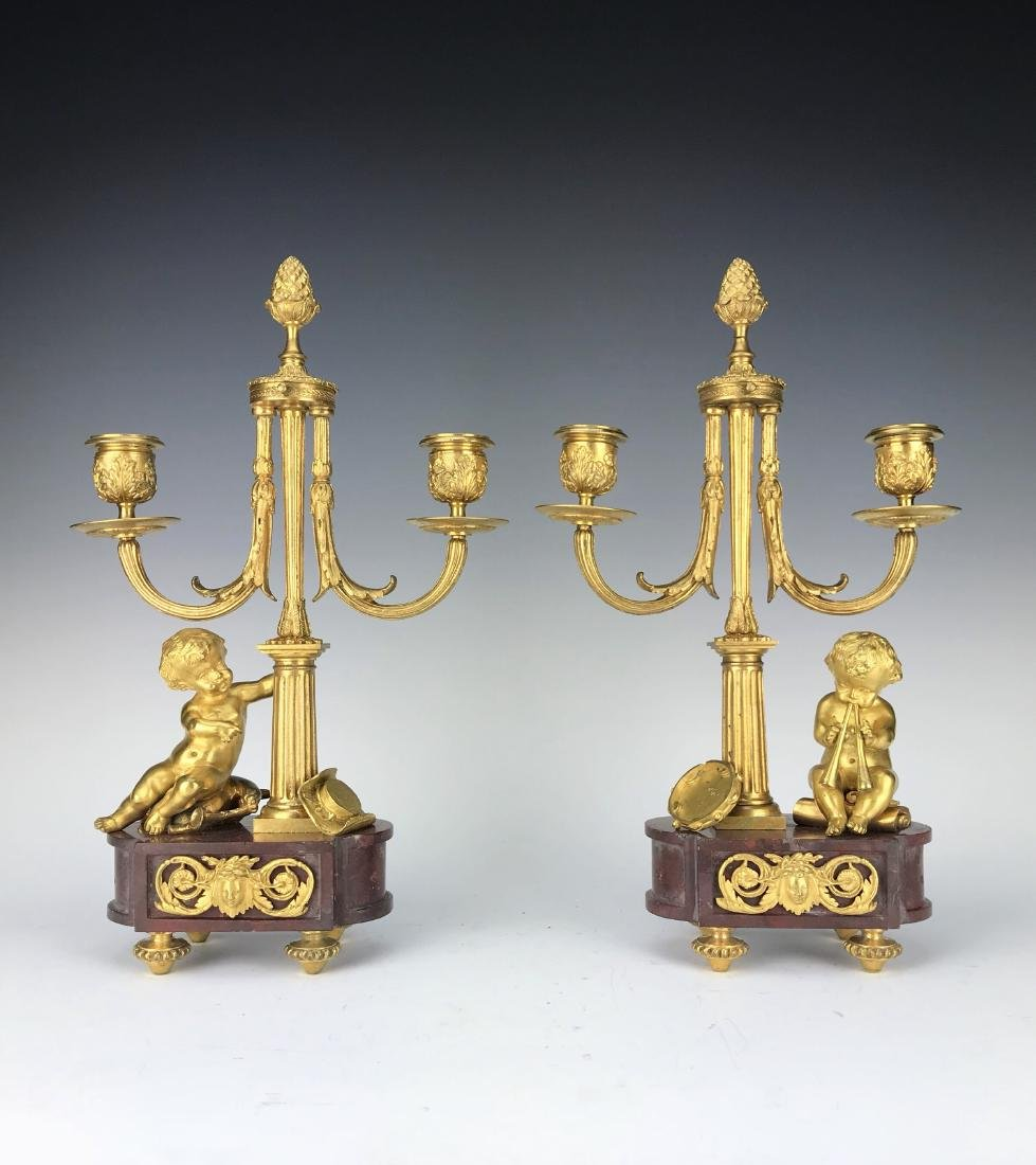 Pair of French Figural Bronze & Rouge Marble Candelabra
