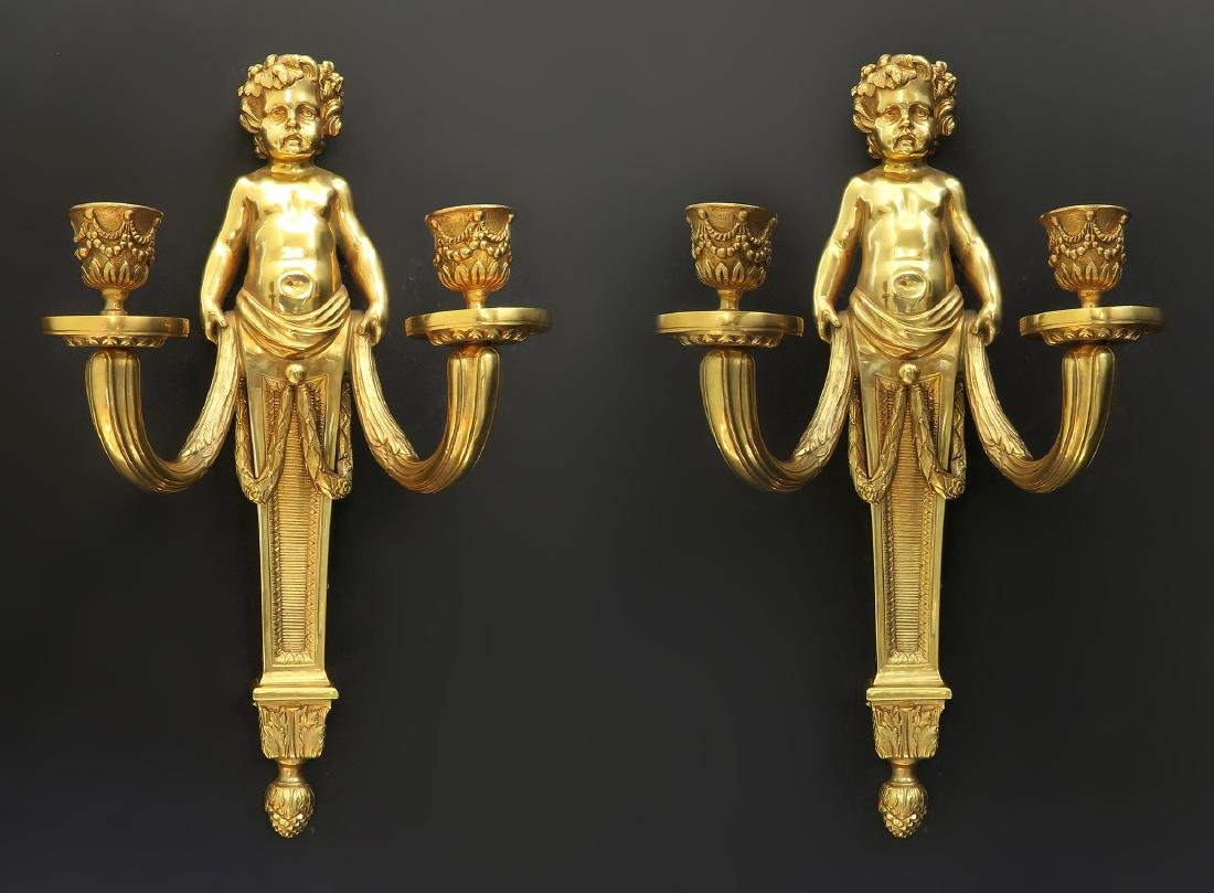 A Pair of French Figural Bronze Sconces. 19th C.