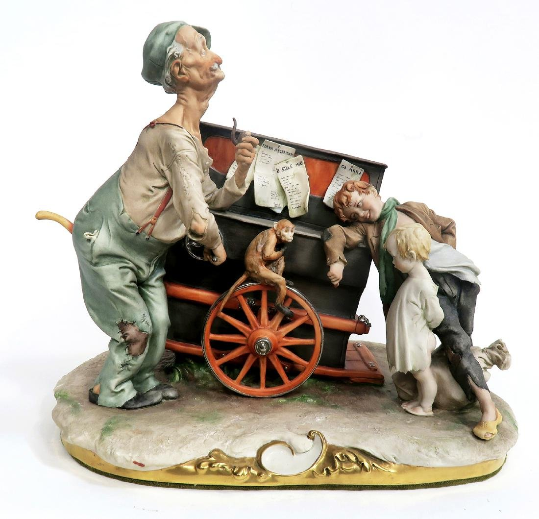 "SIGNED ""G. GALLE"" PORCELAIN FIGURINE MUSIC BOX"
