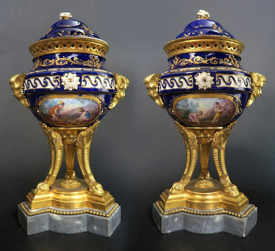 A Pair of French Bronze & Sevres Porcelain Urns