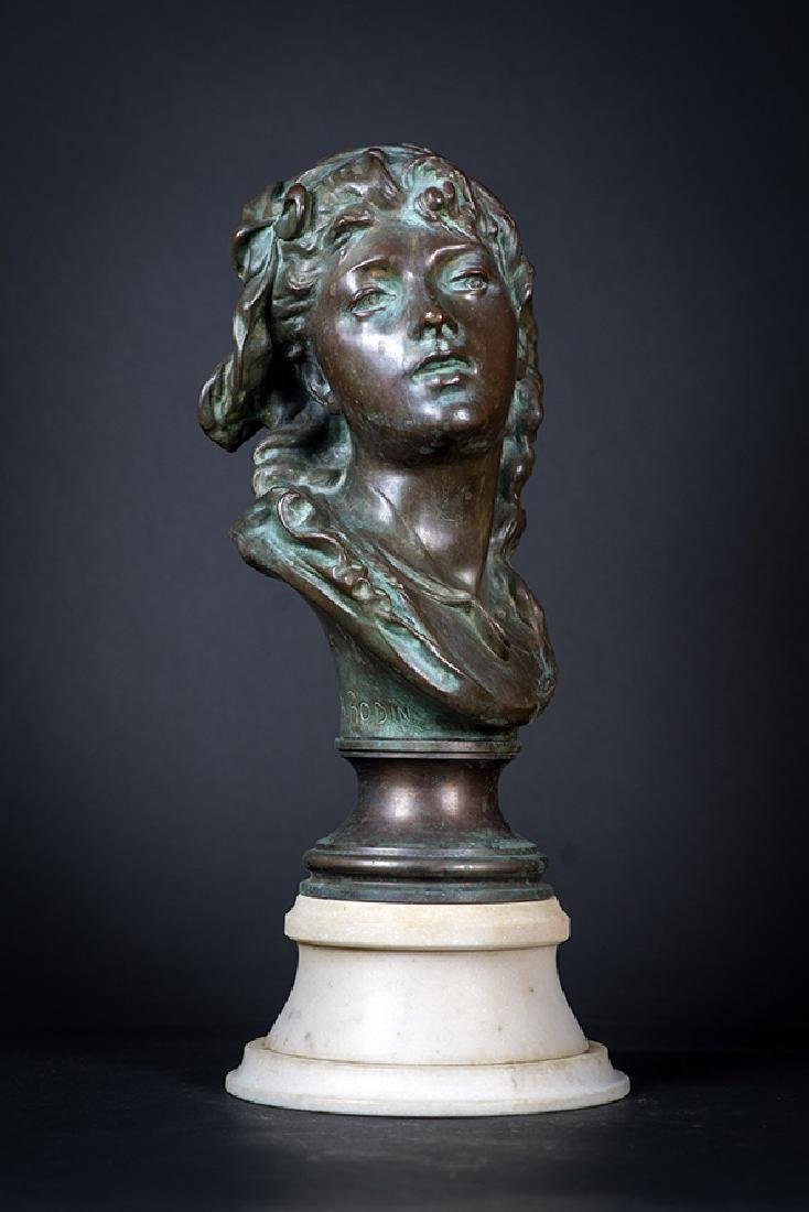 A Bronze Sculpture on Marble Base