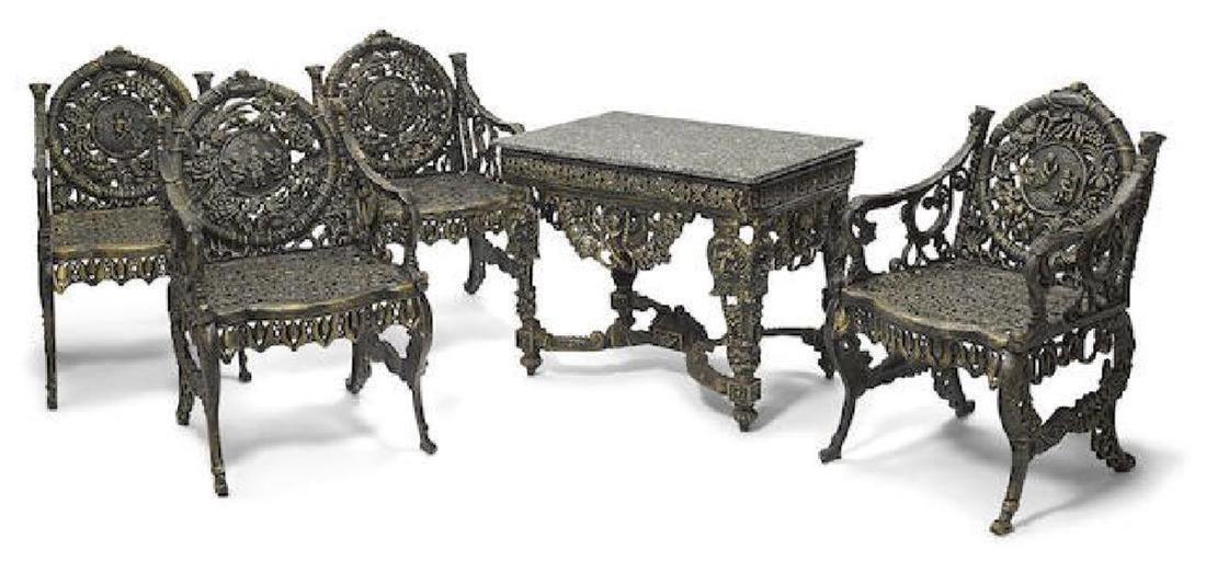 A cast iron suite of garden furniture