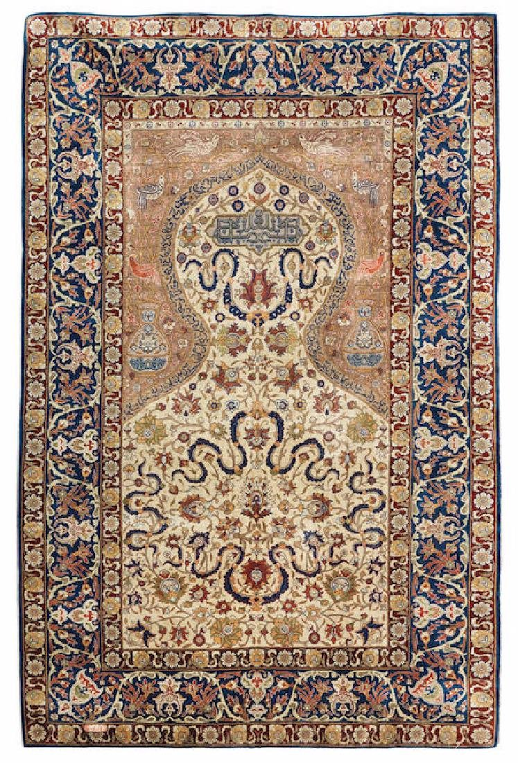 A HEREKE SILK PRAYER RUG
