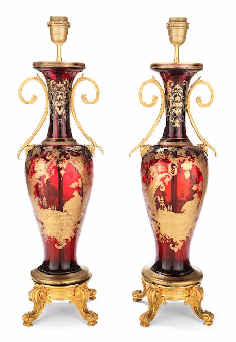 PAIR OF GILT BRONZE MOUNTED RUBY GLASS VASE LAMP BASES