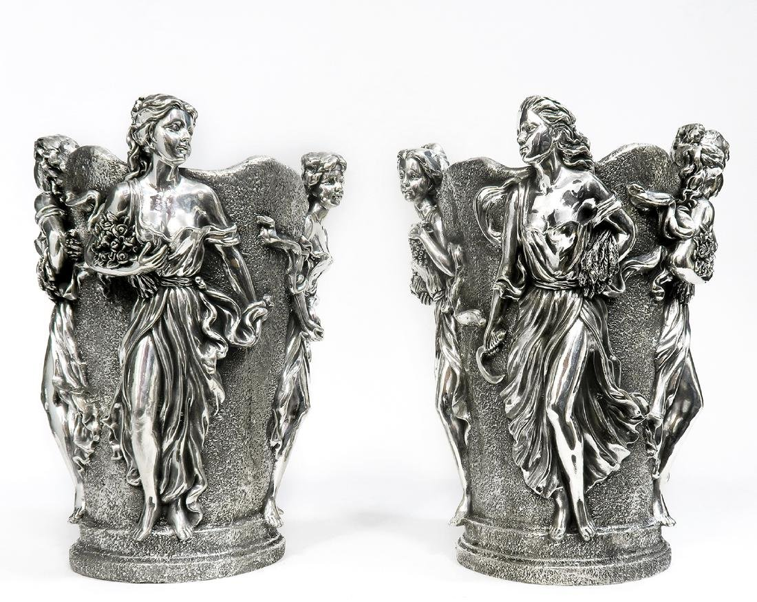 A Pair of Large Figural Sterling Silver Vases