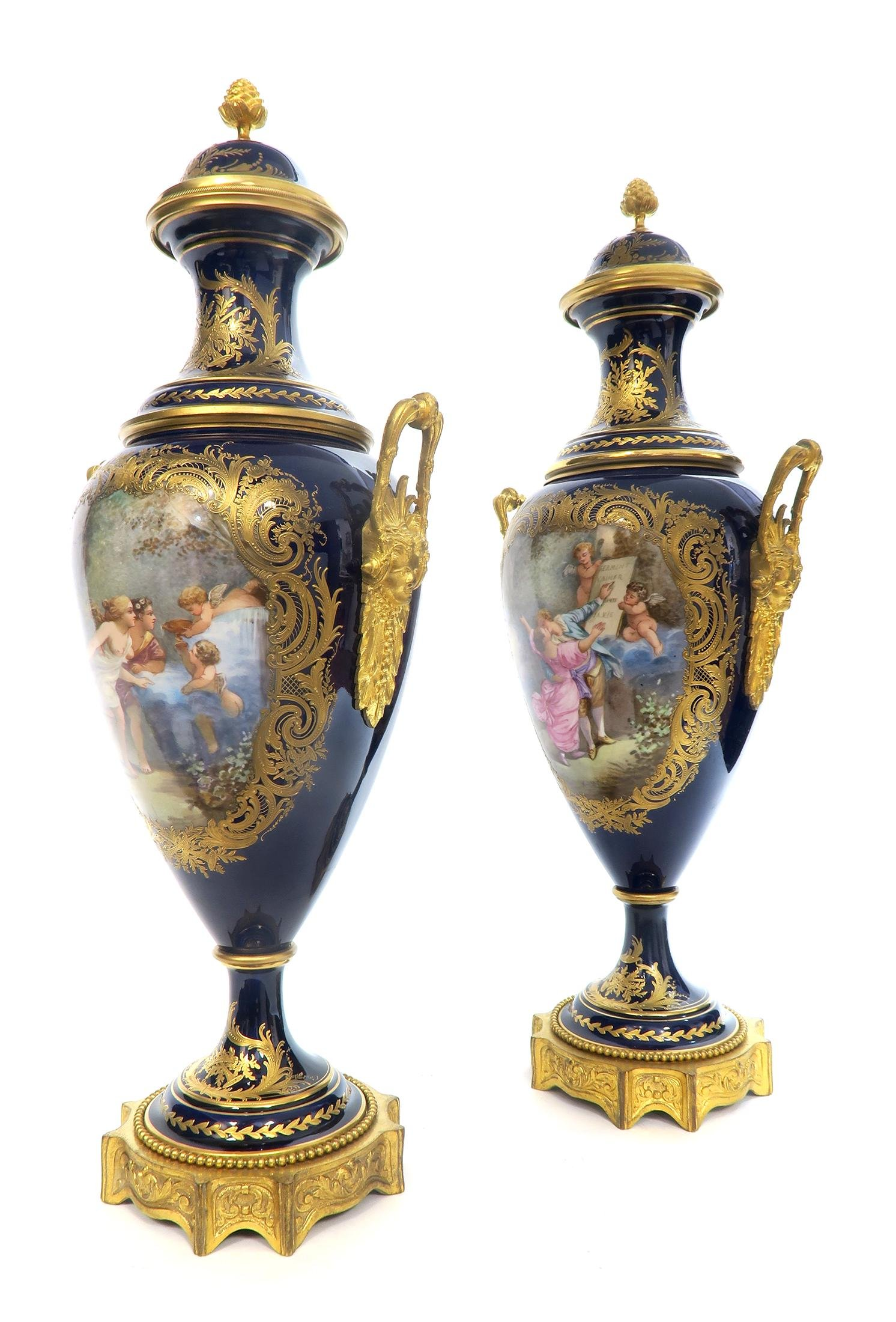 French Pair of 19th C. Sevres Hand Painted Vases/Urns