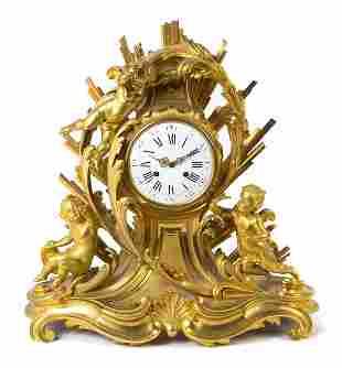 A Napoleon III Gilt Bronze Mantel Clock