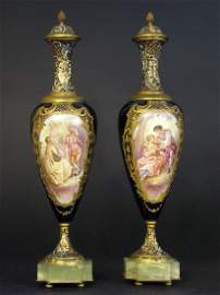 Pair of French Champleve and Onyx mounted covered Urns