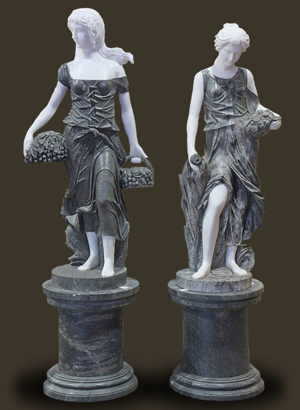 Continental style carved marble sculptures