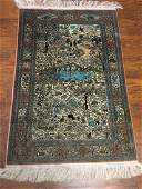 A Hand Made Oriental Silk Rug