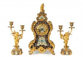 A French gilt bronze and champlevé clock garniture,