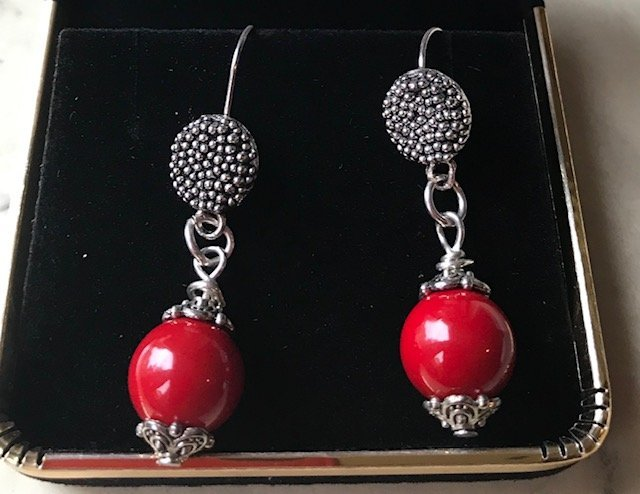 A Pair of Red Coral and sterling Silver Earrings