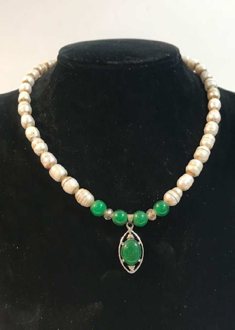 Green Jade Pendant on Pearl Necklace