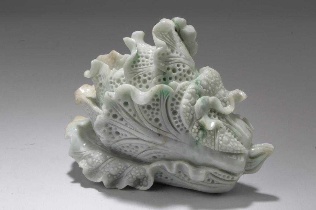 Intricately carved white cabbage jade ornament