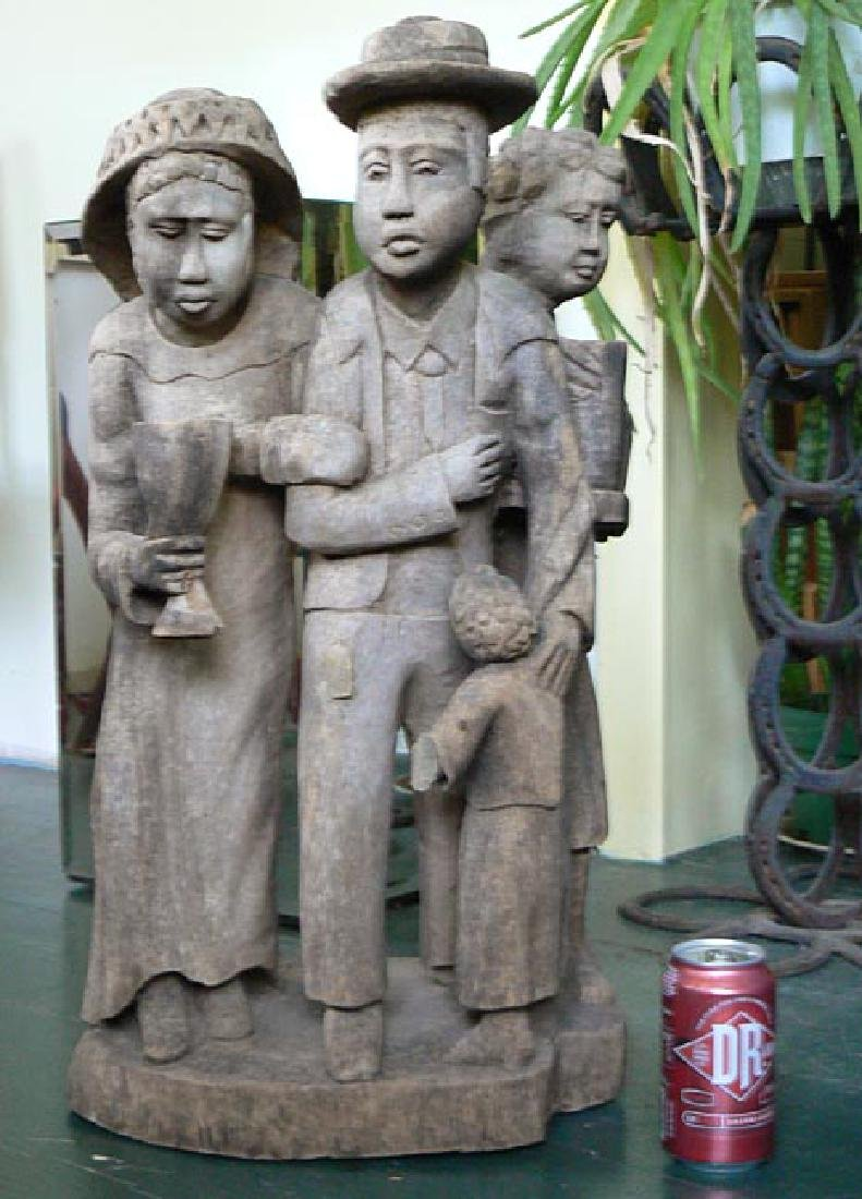 Incredible carving of an African-American family. - 10