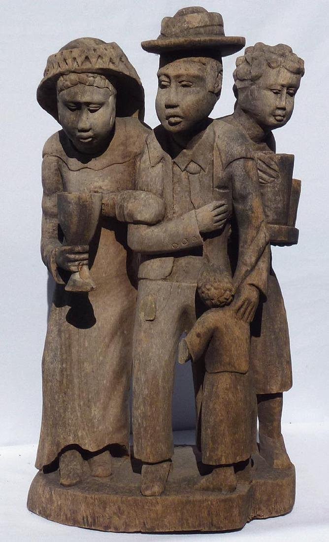 Incredible carving of an African-American family.