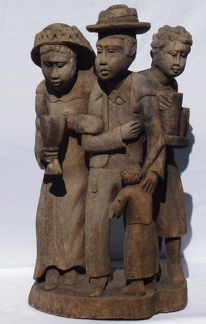 Incredible carving of an African-American family. - 2