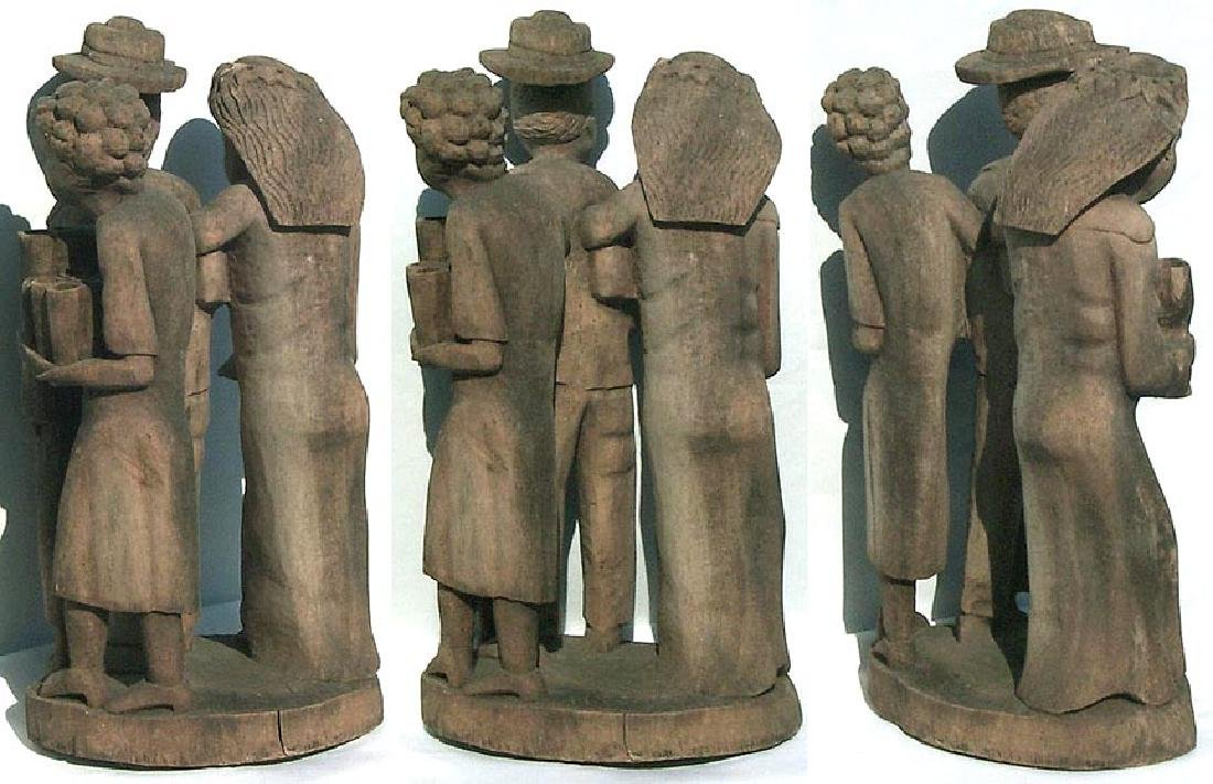 Incredible carving of an African-American family. - 4
