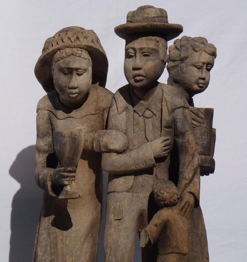 Incredible carving of an African-American family. - 7