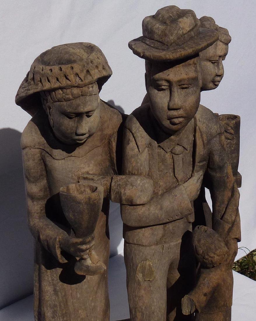 Incredible carving of an African-American family. - 8