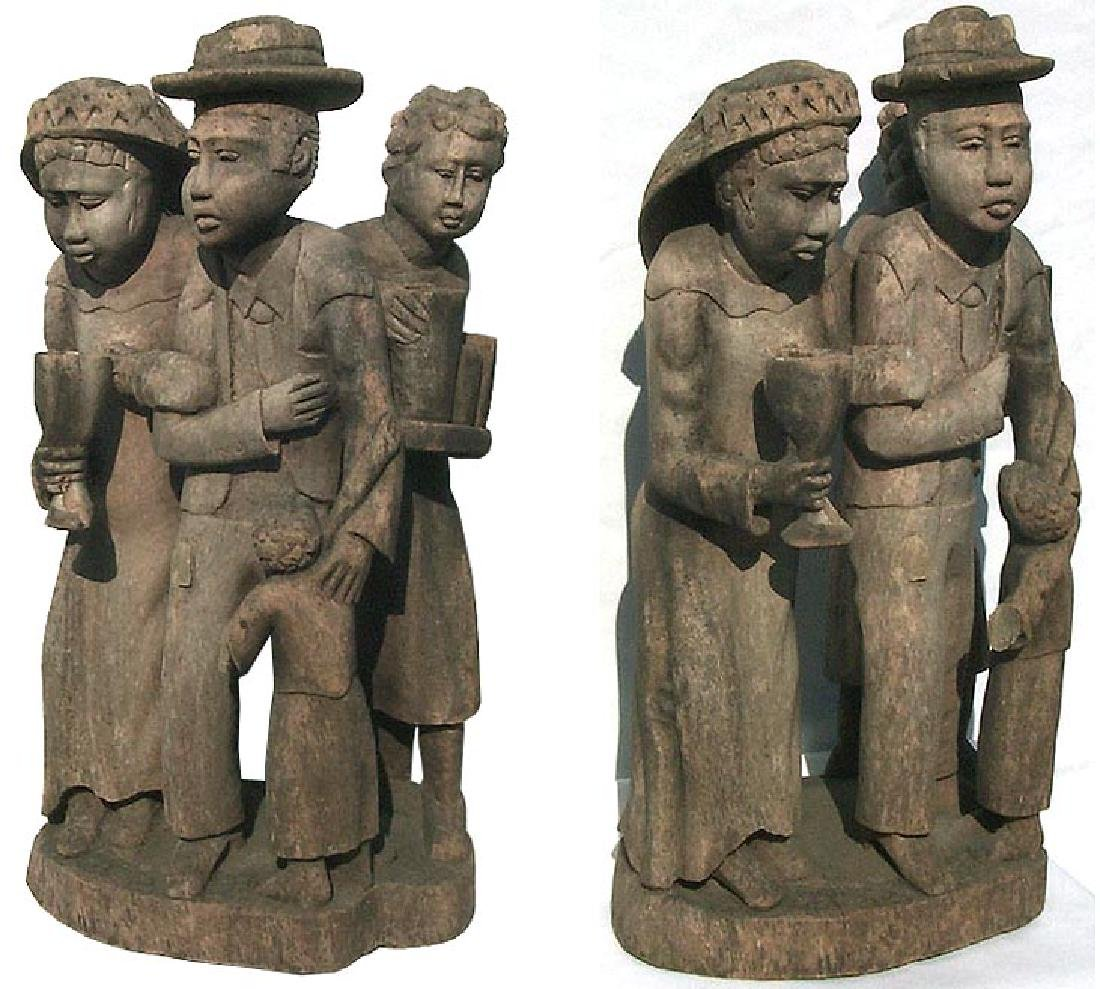 Incredible carving of an African-American family. - 9