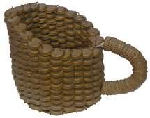 Folk Art pitcher made from bottle caps
