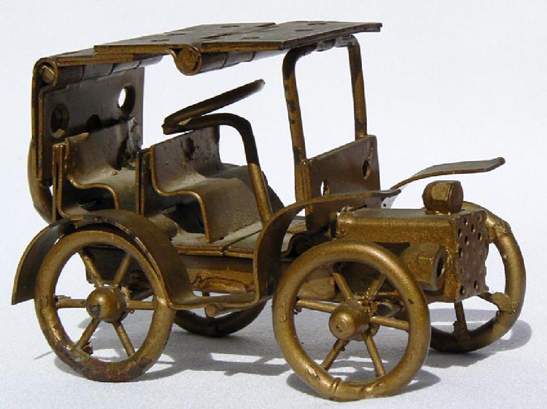 Small Folk Art metal model of an antique car