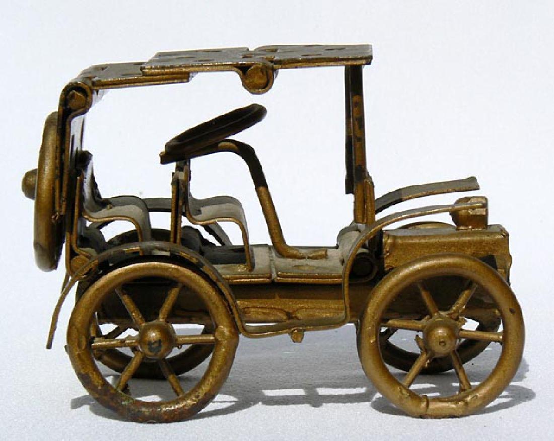 Small Folk Art metal model of an antique car - 3