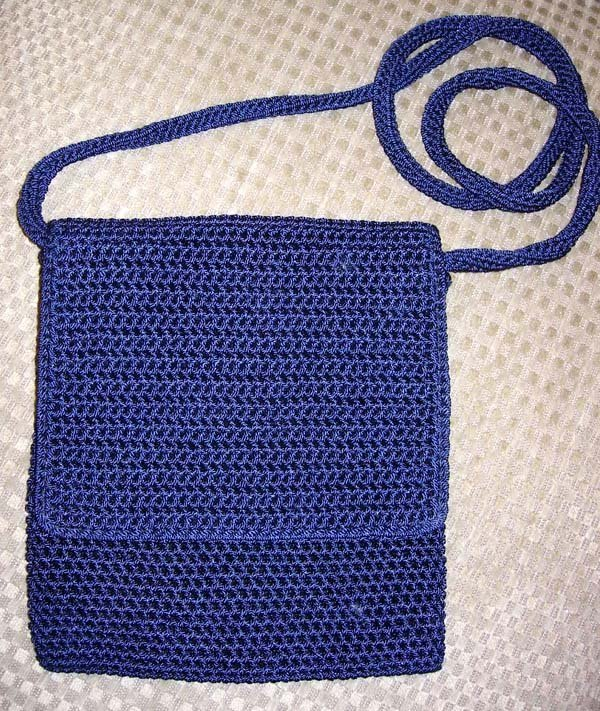 41: SMALL BLUE CROCHET PURSE BY THE SAK
