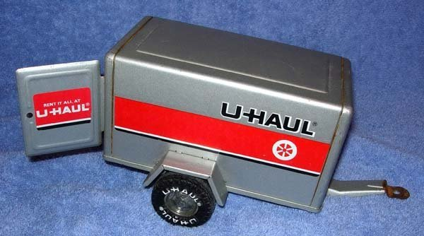 1353: VINTAGE U-HAUL TOY TRAILER WITH BACK DOOR
