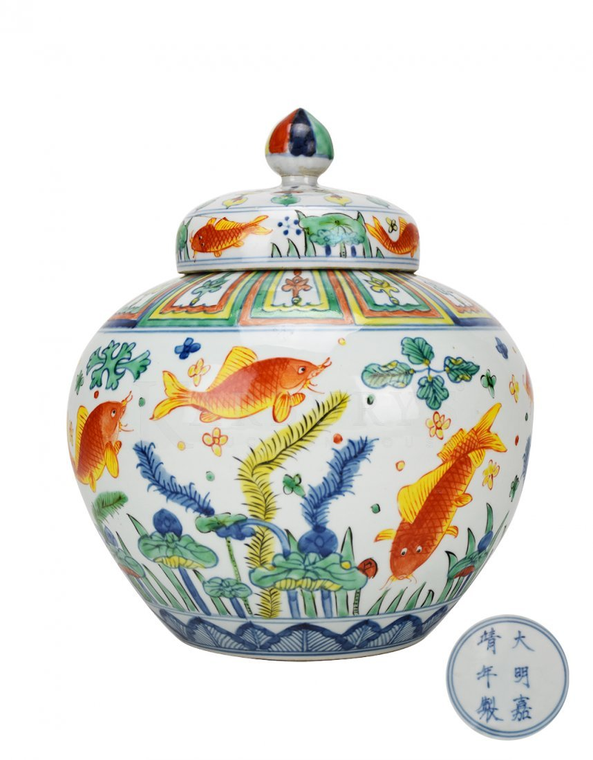 A Wucai Fish Jar with Cover with a Jiajing Mark