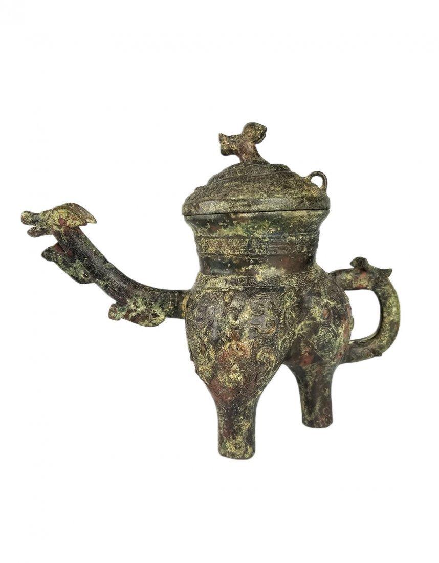 A Bronze Ritual Wine Vessel and Cover