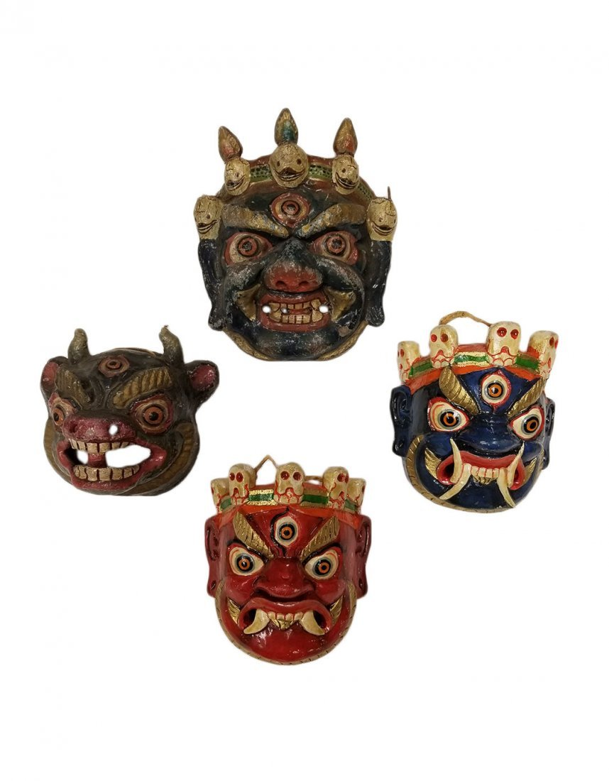 A set of four miniture ceremonial painted masks.