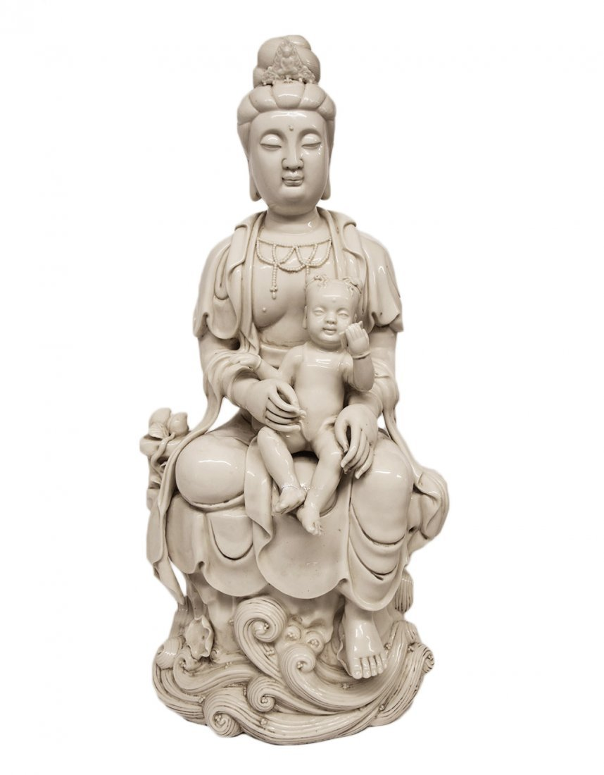 A Blanc de Chine Sculpture of Quan Yin with Child