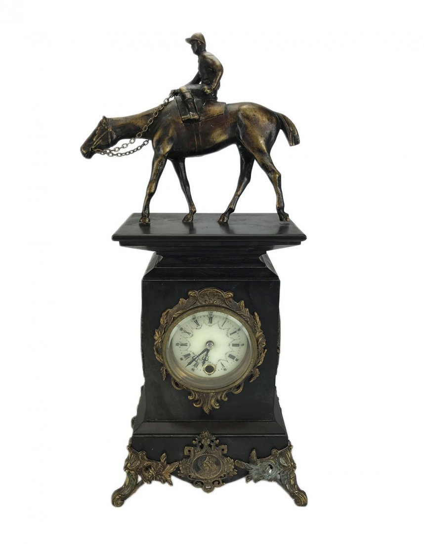 An Ornate Black Slate, Marble and Bronze Mantel Clock
