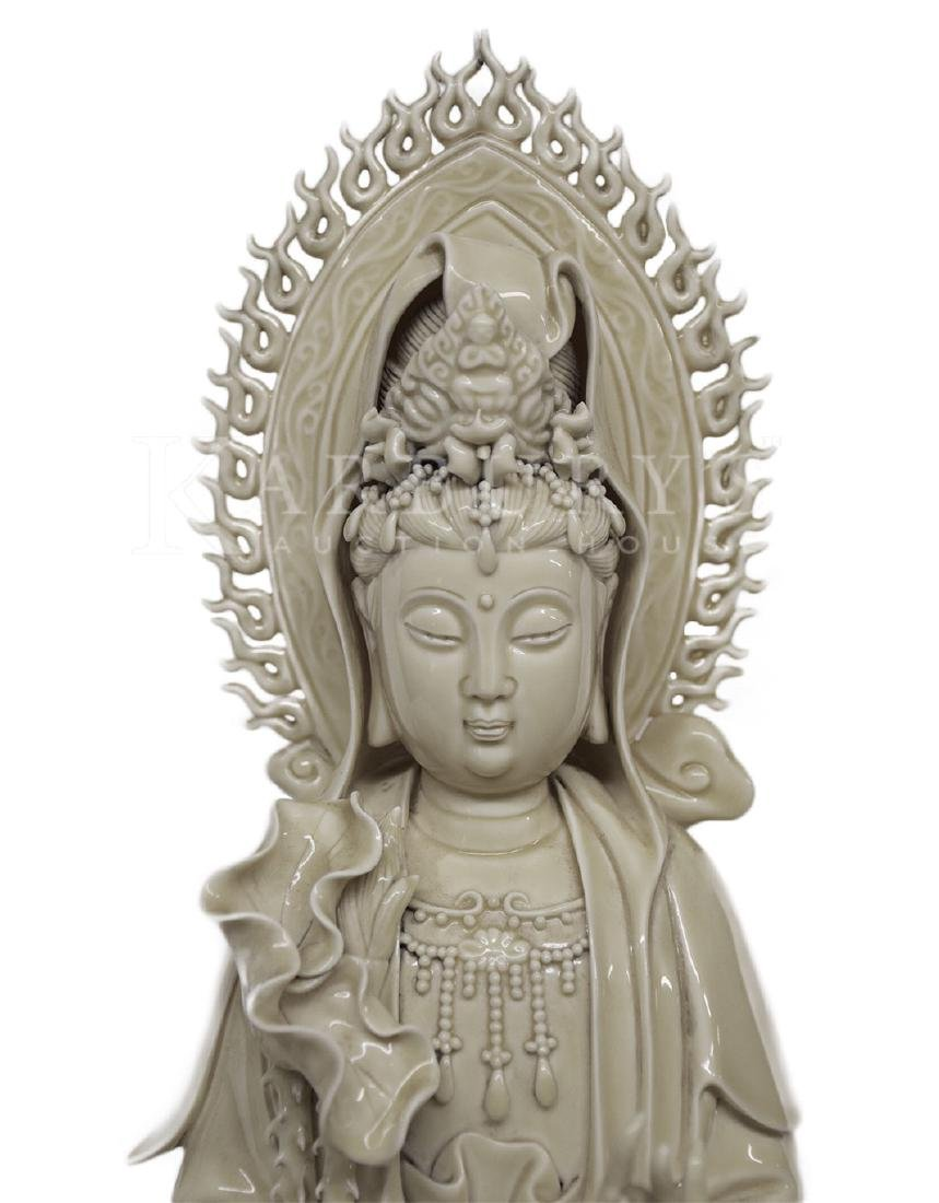 A Blanc de Chine Guan Yin Standing on a Dragon