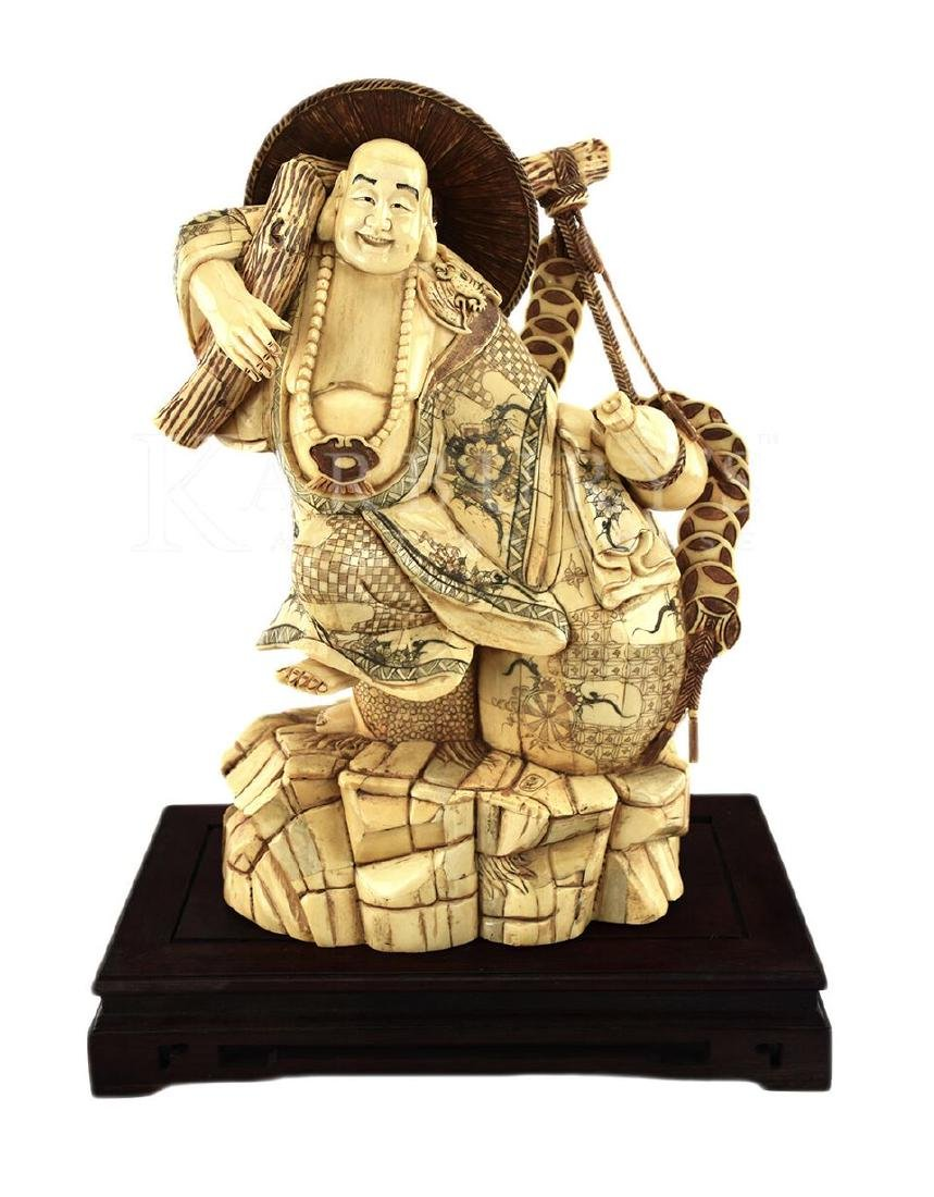 A Japanese Carved Bone Fisherman Figure