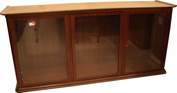 412: Counter top show case Mahogany 3 door