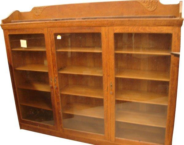 419: Oak 3 door bookcase 7 ft long