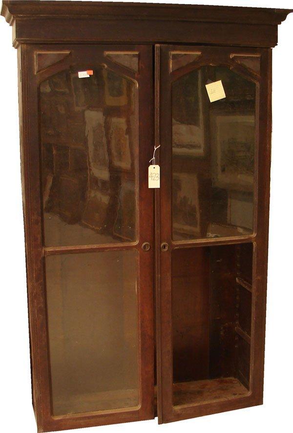423: Walnut Step Back Victorian bookcase 8ft. tall