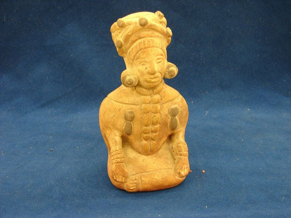 2501: Colombian reproduction figurine of a seated man (