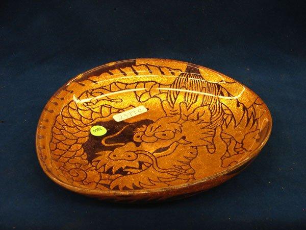 2509: Gold Dragon Textile encased in glass, marked Rari