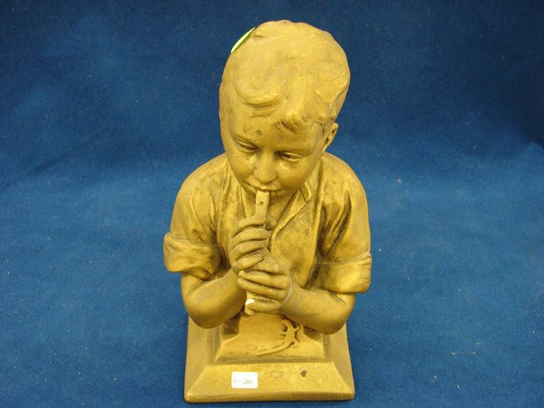 2511: Small bust of young boy playing flute, brass colo