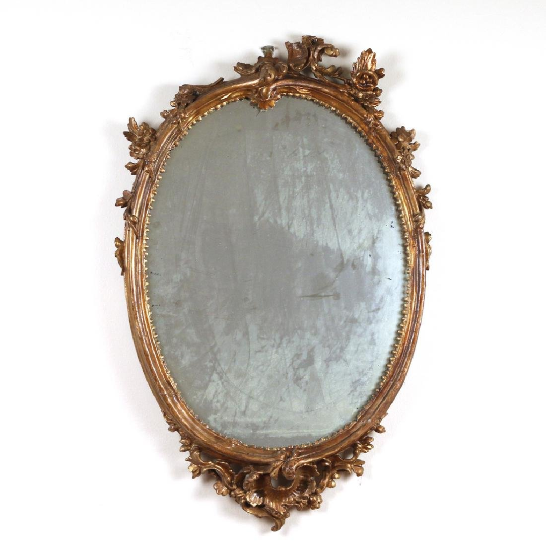 OVAL FRENCH GILT-CARVED WALL MIRROR